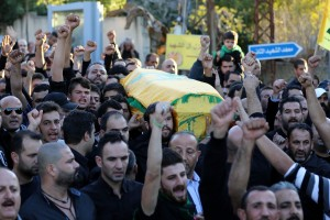 Mourners chant slogans as they carry the body of Adel Termos, who was killed in a twin bombing attack that rocked a busy shopping street in the area of Burj al-Barajneh in Beirut's southern suburb, during his funeral in the village of Tallussa in the Nabatiyeh governorate, south of Lebanon on November 13, 2015. Lebanon mourned 44 people killed in south Beirut in a twin bombing claimed by the Islamic State group, the bloodiest such attack in years, the Red Cross also said at least 239 people were also wounded, several in critical condition. AFP PHOTO / MAHMOUD ZAYYAT